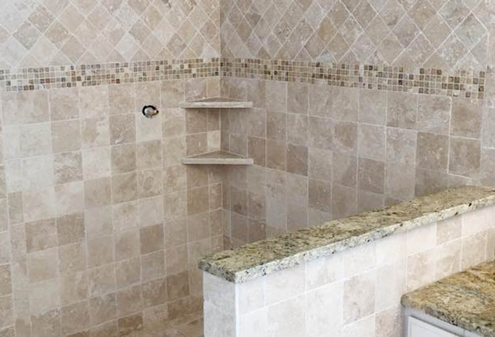 shower with tile work on walls